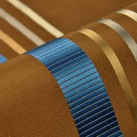 Lourmel - Brown Blue - White, silver, gold and Royal blue stripes with a slight sheen on fabric made fromwalnut brown coloured 100% silk