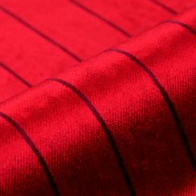 Inconel - Red - Rich scarlet coloured dralon and polyester blend fabric behind a simple design of thin, evenly spaced black lines