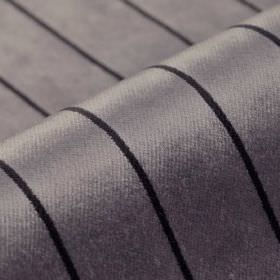 Inconel - Purple - A simple design of thin lines at even intervals over dralon and polyester blend fabric in black and lilac-grey colours