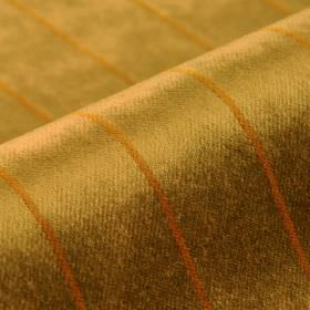 Inconel - Gold - Dark honey coloured lines printed in a thin evenly spaced stripe design on metallic gold dralon and polyester blend fabric