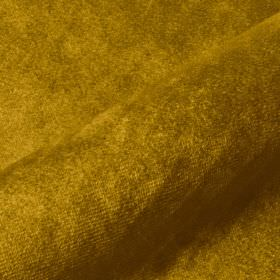 Teatro - Gold - Very slightly textured dark gold-green coloured fabric made from dralon and polyester