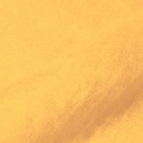 Teatro - Yellow1 - Light creamy orange coloured fabric blended from a mixture of dralon and polyester