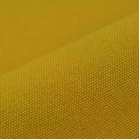 Samba - Orange Gold - Gold and lime green colours blended together to cover a plain fabric made from a combination of cotton and viscose
