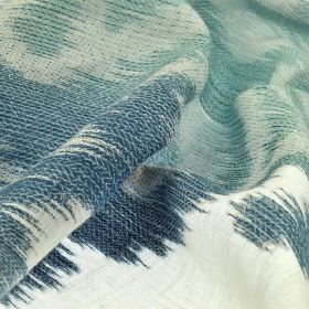 Rinjani - Cream Blue - White and various different shades of marine blue making up patchily coloured cotton, linen and polyester blend fabri