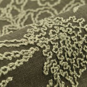 Eldborg - Brown (2) - Linen and viscose blended into a dark grey coloured fabric behind a raised wiggling line pattern in very pale grey-whi