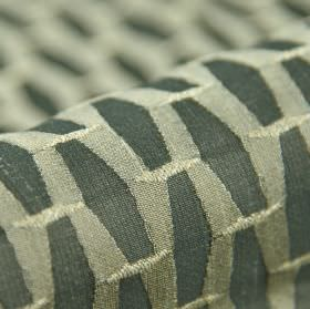 Grid CS - Grey Green (5) - 100% Trevira CS fabric covered with a repeated geometric print pattern in off-white and graphite grey colours