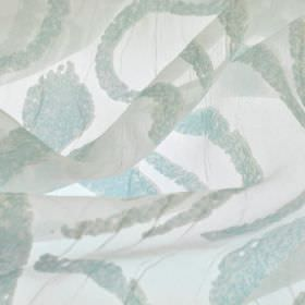 Hydrus - Blue - Translucent fabric made from polyester and viscose in white, with a random, abstract pattern of lines invery light blue