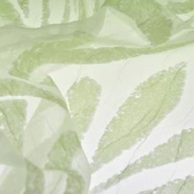 Hydrus - Green - Polyester and viscose blended together into a translucent white and light green fabric, patterned with random abstract lines
