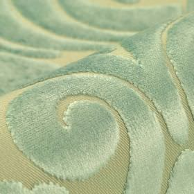 Aries - Ice Blue - Pale blue and green colours making up a large, slightly textured swirl pattern on fabric made from polyester and viscose
