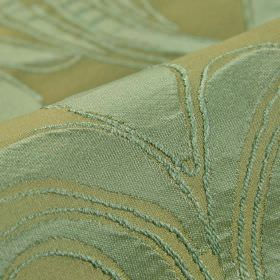Indus - Green (5) - Fabric made from 100% polyester with a dusky mint green simple leaf design on an olive green coloured background