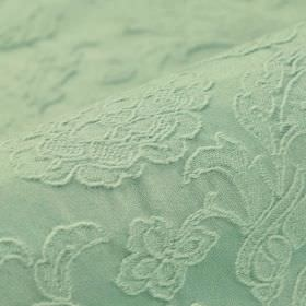 Musca - Green - Delicate flowers and leaves embroidered in a raised pattern on cotton and polyester blend fabric in a blue-white colour