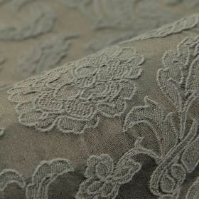 Musca - Grey - A raised, embroidered pattern of delicate flowers and leaves on cotton and polyester blend fabric in two dark grey shades