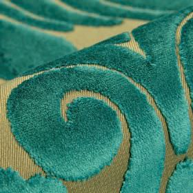 Aries - Teal - Polyester and viscose blend fabric in green-grey behind a large swirl pattern with a soft texture in a deep teal colour