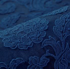 Musca - Blue - Rich navy blue coloured fabric made from cotton and polyester with a raised, embroidered delicate floral and leaf design
