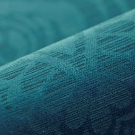 Lynx - Blue (3) - A simple, subtle, striped leaf pattern arranged on 100% polyester fabric in a dark aquamarine colour