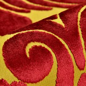 Aries - Red - Citrus and maroon coloured polyester and viscose blend fabric featuring a large swirl pattern finished with a soft texture