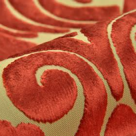 Aries - Light Red (14) - Fabric made from polyester and viscose in light cream-green and brick red colours, with a large, textured swirl pat