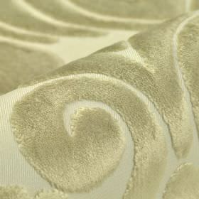 Aries - Cream - Large swirls and patterns with a soft texture and shiny silver colouring on pale grey polyester and viscose blend fabric