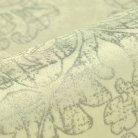 Columba - White Silver (1) - Patchy grey colouring on a swirl pattern over a cream coloured cotton, polyester and viscose blend fabric backg