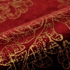 Columba - Red Gold (4) - Extravagant fabric made from cotton, polyester and viscose in rich ruby and gold colours, with a patchy swirl patte