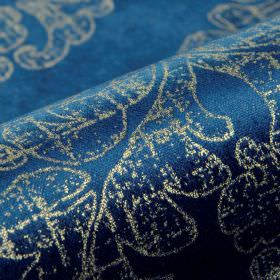 Columba - Blue Gold - Cotton, polyester and viscose blend fabric made in rich Royal blue and grey shades, with a patchily printed swirl desi