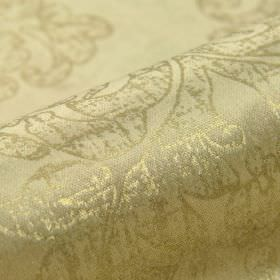 Columba - Beige - Fabric made from cotton, polyester and viscose with a patchy swirl design printed in two different shades of gold