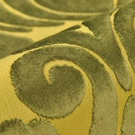 Aries - Brown Gold (6) - Light yellow polyester and viscose blend fabric behind a dark khaki-grey coloured large, textured swirl design