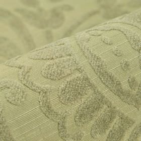 Cetus - Beige - Fabric made from a green-grey blend of several materials, with a subtly textured pattern of very simple leaf shapes