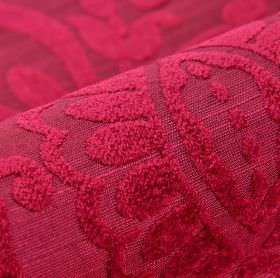 Cetus - Red (8) - A soft texture covering simple leaf shapes on rich ruby red coloured fabric made from several different materials