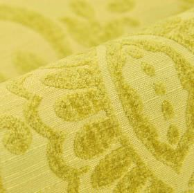 Cetus - Yellow - Simple leaf shapes covered with a soft texture, on fabric made from modal, polyester and viscose-chenille in citrus yellow