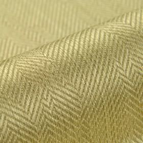 Ara - Beige (2) - Fabric made from warm gold coloured cotton and viscose, featuring a subtle but irregular herringbone pattern