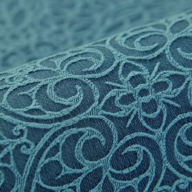 Samburu - Blauw - Fabric made from cotton and polyester with a simple flower and swirling heart design in powder and denim shades of blue