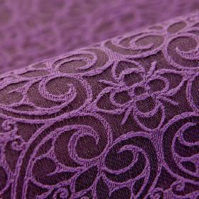 Samburu - Paars (7) - Violet and aubergine coloured cotton and polyester blend fabric, featuring a repeated floral and swirling heart design