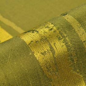 Astato 300cm - Gold Green1 - Slightly shiny grass and lime green coloured stripes in a patchy design on olive green polyester and viscose blen