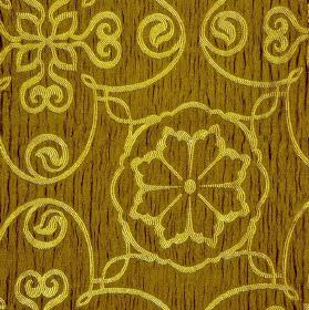 Selenio - Brown Yellow (2) - Yellow-brown polyester and viscose blend fabric behind a simple, delicate pattern of flowers and swirls in citr