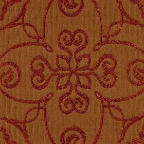 Selenio - Red Orange - Polyester and viscose blend fabric in warm brown behind a simple pattern of flowers and swirls in a dark burgundy col