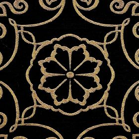 Selenio - Black Brown - Fabric made from black and golden cream coloured, flower and swirl patterned polyester and viscose