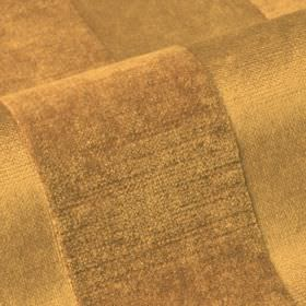 Stopera - Brown1 - A textured stripe design covering cotton, modal and polyester blend fabric in a warm, rich brass colour
