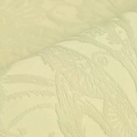 Auden - Cream - Intricate but subtle patterns covering cotton and polyester blend fabric in a very pale yellow-cream colour
