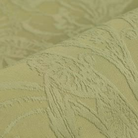 Auden - Beige (3) - Fabric made from grass green coloured cotton and polyester with a subtle design of intricate flowers, swirls and patterns