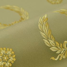 Royal Victoria - Brown (24) - A background of olive green cotton and rayon blend fabric to a light green and green-gold design of garlands a