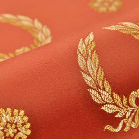 Royal Victoria - Red (26) - A repeated design of cream and caramel garlands and flowers on cotton and rayon blend fabric in a terracotta col