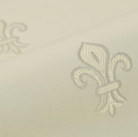 Royal Astoria - White - Simple fleur de lis patterns embroidered in cream and light grey on putty coloured fabric made from cotton and rayon