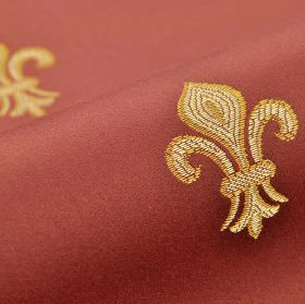 Royal Astoria - Red Pink - Small, simple fleur de lis designs embroidered in gold and cream on brick red coloured fabric made from cotton an