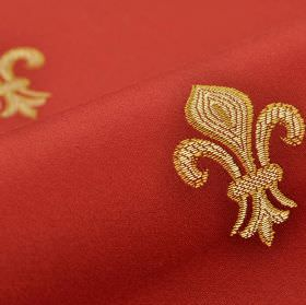 Royal Astoria - Red - Fabric made from ruby red coloured cotton and rayon, with a repeated fleur de lis design embroidered in cream and gold