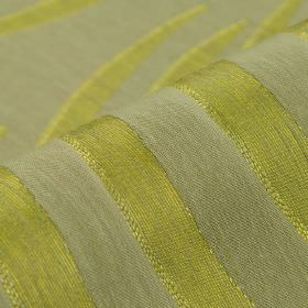 Makio CS - Green Grey (6) - Lime and light shades of green making up a large pattern of sweeping curved lines on 100% Trevira CS fabric