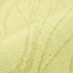Oezon - Cream (1) - Random wavy lines patterning a light yellow coloured linen and polyester blend fabric in a light green-grey colour
