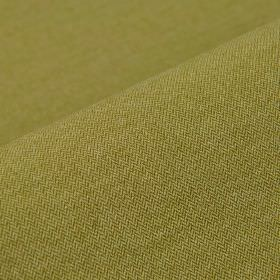 Salina - Green Brown (7) - Fabric made from a plain blend of leaf green coloured polyester and viscose