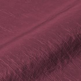 Skip - Purple (22) - Luxurious dark plum coloured fabric made with a few slightly raised threads from a blend of polyamide and polyester