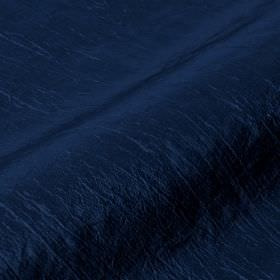 Skip - Blue (28) - Fabric made from polyamide and polyester with a few very subtle raised threads in a very deep shade of midnight blue